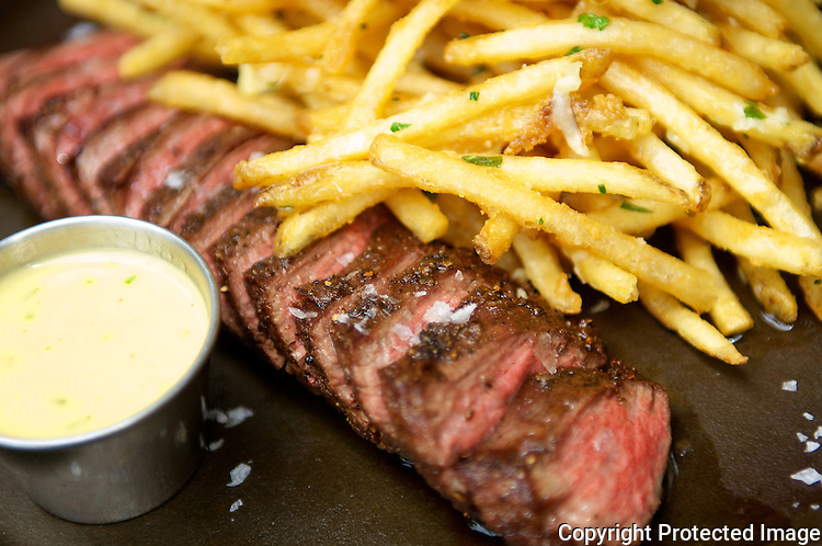 Steak frites with a St. Emilion wine at Le Coop Bistro in Louisville, Ky.
