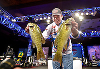 NWA Democrat-Gazette/BEN GOFF -- 04/25/15 Cody Meyer, FLW pro from Auburn, Calif., weighs-in on day three of the Walmart FLW Tour at Beaver Lake on Saturday Apr. 25, 2015 at the John Q. Hammons Center in Rogers. Meyer stood in 5th place after day three.