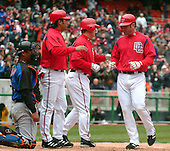 Washington, D.C. - April 3, 2005 -- Washington Nationals Ryan Church, right, is congratulated by teammates Brad Wilkerson, center, and Vinny Castilla, left, after hitting a three-run home run in the second inning of their exhibition game against the New York Mets at RFK Stadium in Washington on  April 3, 2005. .Credit: Ron Sachs / CNP.(RESTRICTION: NO New York or New Jersey Newspapers or newspapers within a 75 mile radius of New York City)