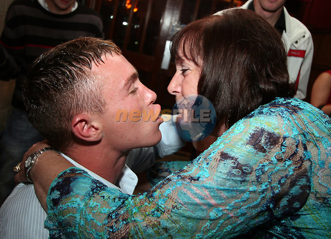 David Byrne saves his 21st kiss for his mam at his 21st birthday in the Rugby Club...Photo NEWSFILE/Jenny Matthews.(Photo credit should read Jenny Matthews/NEWSFILE)....This Picture has been sent you under the condtions enclosed by:.Newsfile Ltd..The Studio,.Millmount Abbey,.Drogheda,.Co Meath..Ireland..Tel: +353(0)41-9871240.Fax: +353(0)41-9871260.GSM: +353(0)86-2500958.email: pictures@newsfile.ie.www.newsfile.ie.FTP: 193.120.102.198.