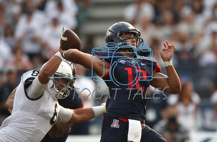 Nevada's Ian Seau pressures Arizona quarterback Anu Solomon an NCAA college football game against Arizona in Reno, Nev., on Saturday, Sept. 12, 2015.(AP Photo/Cathleen Allison)