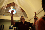 BAGHDAD, Iraq: 13th June 2014<br /> <br /> A man prays during mass at the St. Georges Chaldean Church in the mainly Shiite suburb of New Baghdad<br /> <br /> Fixer: Haider Kata +9647704425647<br /> <br /> Ayman Oghanna for National Geographic