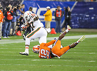 Charlotte, NC - December 2, 2017: Miami Hurricanes tight end Michael Irvin II (87) gets tackled by Clemson Tigers defensive back K'Von Wallace (12) during the ACC championship game between Miami and Clemson at Bank of America Stadium in Charlotte, NC.  (Photo by Elliott Brown/Media Images International) Clemson defeated Miami 38-3 for their third consecutive championship title.