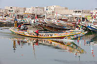 Senegal, Saint Louis.  Fishing Boat on the River Senegal Headed out to Sea.