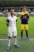 Pictured L-R: Players Leon Britton with the home kit and Ben Davies wearing the away kit and at the official launch of the 2013-2014 Swansea City Football Club kit launch at the Liberty Stadium, Swansea, south Wales. Friday 28th of June 2013