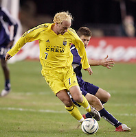 The Columbus Crew's Simon Elliot is shadowed by Pat Noonan of the New England Revolution.  The New England Revolution defeated the Columbus Crew 3 to 0 during the Revolution's MLS home opener at Gillette Stadium, Foxboro. MA, on Saturday April 9, 2005.