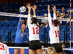BROOKINGS, SD - SEPTEMBER 4:  Nazya Thies #6 from South Dakota State tries to tip the ball past Kathryn Graf #12 and Allison Turner #18 from Bradley in their match Sunday afternoon at Frost Arena in Brookings. (Photo by Dave Eggen/Inertia)