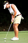 Gerina Mendoza putted the ball into the 13th hole during Alliance Bank Golf Classic in Syracuse NY.