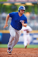 Iowa Cubs designated hitter Dan Vogelbach (20) running the bases during a game against the Nashville Sounds on May 4, 2016 at First Tennessee Park in Nashville, Tennessee.  Iowa defeated Nashville 8-4.  (Mike Janes/Four Seam Images)