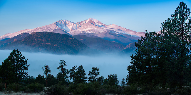 sunrise light on Mt Meeker and Longs Peak above morning fog in the Rocky Mountains, Estes Park, Colorado, USA