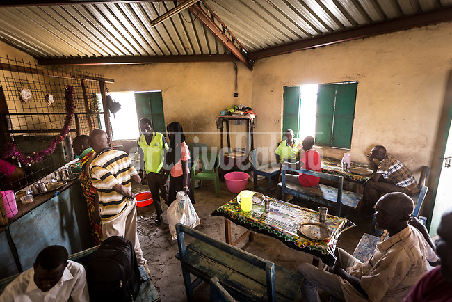 A cofee shop in   Kakuma, Kenya.Kakuma refugee camp in North of Kenya. Kakuma is the site of a UNHCR refugee camp, established in 1991. The population of Kakuma town was 60,000 in 2014, having grown from around 8,000 in 1990. In 1991, the camp was established to host the 12,000 unaccompanied minors who had fled the war in Sudan and came walking from camps in Ethiopia.