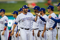 Round Rock Express pitcher Colby Lewis #47 is greeted by his teammates before the Pacific Coast League baseball game against the Oklahoma City Redhawks on April 3, 2014 at the Dell Diamond in Round Rock, Texas. The Redhawks defeated the Express 7-6 in the season opener for both teams. (Andrew Woolley/Four Seam Images)