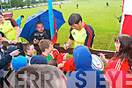 The Munster teams visit to Tralee Rugby club on Friday for an open training session which ran in conjunction with the Munster Rugby Summer Camp. Pictured is Donncha O'Callaghan signing autographs.