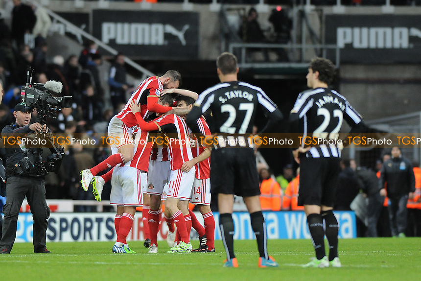 Sunderland players celebrate at the final whistle - Newcastle United vs Sunderland AFC - Barclays Premier League Football at St James Park, Newcastle upon Tyne - 21/12/14 - MANDATORY CREDIT: Steven White/TGSPHOTO - Self billing applies where appropriate - contact@tgsphoto.co.uk - NO UNPAID USE