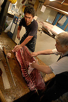 One of the shop's tuna knives in use at Tsukiji fish market.