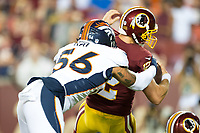 Landover, MD - August 24, 2018: Washington Redskins quarterback Colt McCoy (12) is sacked by Denver Broncos linebacker Shane Ray (56) during preseason game between the Denver Broncos and Washington Redskins at FedEx Field in Landover, MD. The Broncos defeat the Redskins 29-17. (Photo by Phillip Peters/Media Images International)
