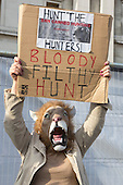 "15 March 2014, London, UK. Global March for Lions in Trafalgar Square, London. The protesters called for a ban on ""canned hunting"" and to ""save our lions"". Canned hunting does not give the animal a chance to escape."
