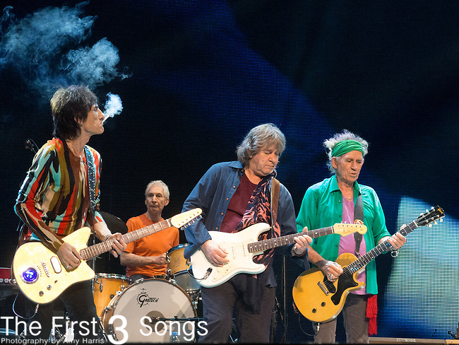 Ronnie Wood, Charlie Watt, Mick Taylor, and Keith Richards of The Rolling Stones perform at TD Garden in Boston, Massachusetts.