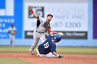 Hickory Crawdads second baseman Carlos Arroyo (25) makes the turn on a double play over a hard sliding Omar Carrizales (19) during a game against the Asheville Tourists on July 23, 2015 in Asheville, North Carolina. The Crawdads defeated the Tourists 8-6. (Tony Farlow/Four Seam Images)