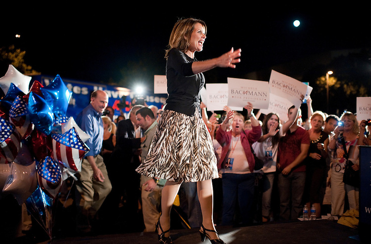 UNITED STATES - AUGUST 12:  Rep. Michele Bachmann, R-Minn., greets supporters during a rally on the campus of Iowa State University in Ames, Iowa, the night before the Ames straw poll.  Rep. Louie Gohmert, R-Texas, appears at left.  (Photo By Tom Williams/Roll Call)