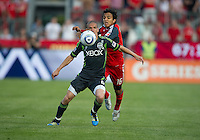 Seattle Sounders FC midfielder Osvaldo Alonso #6 and Toronto FC midfielder Oscar Cordon #16 in action  during an MLS game between the Seattle Sounders FC and the Toronto FC at BMO Field in Toronto on June 18, 2011..The Seattle Sounders FC won 1-0.