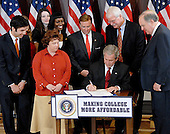 Washington, D.C. - September 27, 2007 -- United States President George W. Bush signs H.R. 2669, the College Cost Reduction and Access Act, at the White House in Washington, D.C. on Thursday, September 27, 2007..Credit: Ron Sachs / CNP