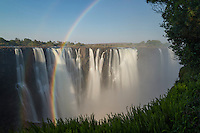 Arced double rainbow in the spray of the Victoria Water Falls