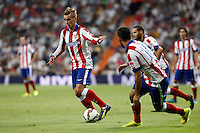 Arda Turan and Griezman of Atletico de Madrid during La Liga match between Real Madrid and Atletico de Madrid at Santiago Bernabeu stadium in Madrid, Spain. September 13, 2014. (ALTERPHOTOS/Caro Marin)