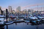 Vancouver area of Granville bridge showing apartment, office blocks marina at dusk.  British Columbia, Canada