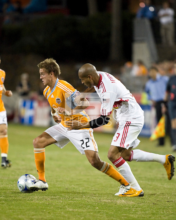 Houston Dynamo midfielder Stuart Holden (22) dribbles away from New York Red Bulls defender Carlos Johnson (3).  Houston Dynamo tied New York Red Bulls 0-0 at Robertson Stadium in Houston, TX onApril 11, 2009.