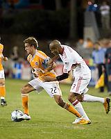 Houston Dynamo midfielder Stuart Holden (22) dribbles away from New York Red Bulls defender Carlos Johnson (3).  Houston Dynamo tied New York Red Bulls 0-0 at Robertson Stadium in Houston, TX onApril 11, 2009.