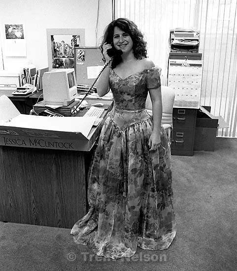 Karen Emanuel wearing an evening dress in the office<br />