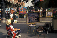 street artist, New Orleans, French Quarter, Louisiana, LA, Street artist display paintings on the sidewalk in the French Quarter of New Orleans.