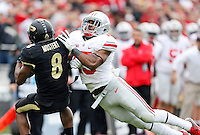 Ohio State Buckeyes running back Ezekiel Elliott (15) tackles Purdue Boilermakers running back Raheem Mostert (8) on a kick return during the third quarter of the NCAA football game at Ross-Ade Stadium in West Lafayette, Ind. on Nov. 2, 2013. (Adam Cairns / The Columbus Dispatch)