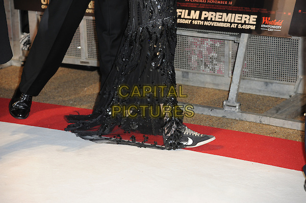 Kristen Stewart's shoes.'The Twilight Saga: Breaking Dawn - Part 1' UK film premiere at Westfield Stratford City, London, England..16th November 2011.black dress sneakers trainers adidas .CAP/CAS.©Bob Cass/Capital Pictures.
