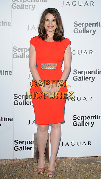 HAYLEY ATWELL .At the Serpentine Gallery Summer Party, Serpentine Gallery, Hyde Park, London, England, UK, July 8th 2010..full length red dress orange platform gold peep toe satin silk shoes clutch bag .CAP/CAN.©Can Nguyen/Capital Pictures.