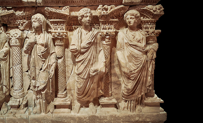 """Roman relief sculpted sarcophagus of Domitias Julianus and Domita Philiska, 2nd century AD, Perge. Antalya Archaeology Museum, Turkey.<br /> <br /> <br /> it is from the group of tombs classified as. """"Columned Sarcophagi of Asia Minor"""". <br /> The lid of the sarcophagus is sculpted into the form of a """"Kline"""" style Roman couch on which lie Julianus &  Philiska. This type of Sarcophagus is also known as a Sydemara Type of Tomb. . Against a black background."""