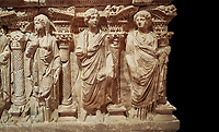 "Roman relief sculpted sarcophagus of Domitias Julianus and Domita Philiska, 2nd century AD, Perge. Antalya Archaeology Museum, Turkey.<br /> <br /> <br /> it is from the group of tombs classified as. ""Columned Sarcophagi of Asia Minor"". <br /> The lid of the sarcophagus is sculpted into the form of a ""Kline"" style Roman couch on which lie Julianus &  Philiska. This type of Sarcophagus is also known as a Sydemara Type of Tomb. . Against a black background."