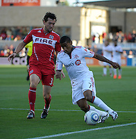 Toronto forward Joao Plata (7) dribbles past Chicago defender Dan Gargan (3).  The Chicago Fire defeated Toronto FC 2-0 at Toyota Park in Bridgeview, IL on August 21, 2011.