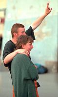 Couple age 24 holding up peace sign.  Krakow Poland