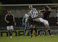 Dylan McGowan goes in high on Jordan Holt in the St Mirren v Heart of Midlothian Clydesdale Bank Scottish Premier League U20 match played at St Mirren Park, Paisley on 6.11.12...