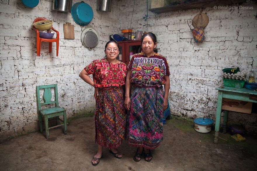 For GLOBAL FUND FOR WOMEN<br /> <br /> Gloria and her mother Juanita at their home. Gloria Marina Icu Puluc from Asociaci&oacute;n Civil de Comadronas Tradicionales de Chimaltenango (ACOTCHI) in San Juan Comalapa, Guatemala on August 20, 2015. Photo credit: B&eacute;n&eacute;dicte Desrus