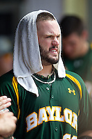 Baylor Bears catcher Josh Ludy #30 in the dugout during the NCAA Regional baseball game against Oral Roberts University on June 3, 2012 at Baylor Ball Park in Waco, Texas. Baylor defeated Oral Roberts 5-2. (Andrew Woolley/Four Seam Images)