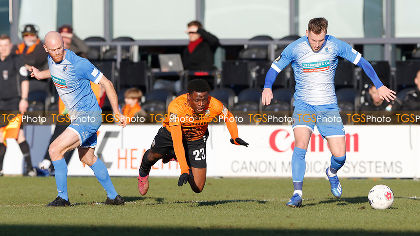 David Tutonda of Barnet takes a tumble after being challenged by Jason Taylor (L) during Barnet vs Barrow, Buildbase FA Trophy Football at the Hive Stadium on 8th February 2020