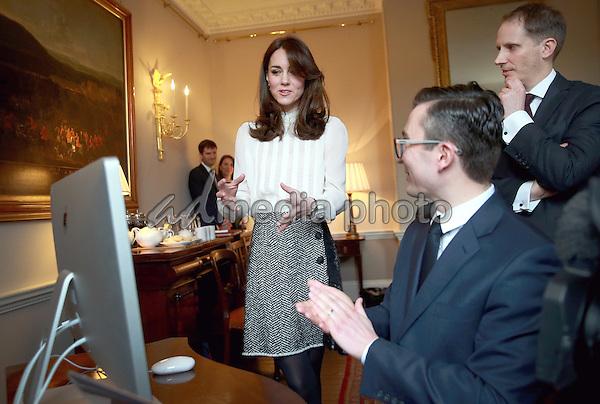 17 February 2016 - London, England - Kate Duchess of Cambridge Catherine Katherine Middleton talks to James Martin (Executive Editor Huff Post UK) and Steven Hull (Editor in Chief Huff Post UK) on the Huffington Post landing page in the 'News Room' at Kensington Palace in London. The Duchess of Cambridge is supporting the launch of the Huffington Post UK's initiative 'Young Minds Matter' by guest editing the Huffington Post UK today from Kensington Palace. Photo Credit: Alpha Press/AdMedia