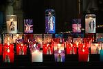 FRANCE - Stack of candles burning in the churc  Sainte-Catherine in Honfleur. Kaarsen branden als verering voor de Heiligen in de houten historische kerk Sainte-Catherine in Honfleur in Normandie, bekend om zijn gescheiden klokketoren die jaarlijks vele toeristen trekt. COPYRIGHT TON BORSBOOM