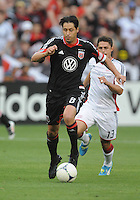 D.C. United defender Dejan Jakovic (8) keeps possession of the ball follow by New England Revolution midfielder Ryan Guy (13)  D.C. United defeated The New England Revolution 3-2 at RFK Stadium, Saturday May 26, 2012.
