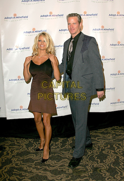 PAMELA ANDERSON & VP of Peta, DAN MATHEWS - MATTHEWS .The 4th Annual Benefit Gala for Adopt-A-Minefield held at The Century Plaza Hotel in Century City, California.October 15th, 2004.full length, brown, black grey, gray suit.www.capitalpictures.com.sales@capitalpictures.com.©Debbie Van Story/Capital Pictures