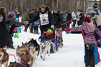 Magnus Kaltenborn and team run past spectators on the bike/ski trail near University Lake with an Iditarider in the basket and a handler during the Anchorage, Alaska ceremonial start on Saturday, March 7 during the 2020 Iditarod race. Photo © 2020 by Ed Bennett/Bennett Images LLC