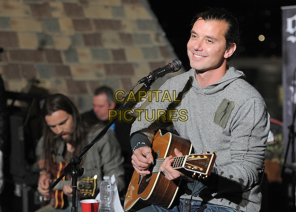 Gavin Rossdale.98.7FM Presents Bush  in an exclusive live performance at the 98.7FM Penthouse inside the Historic Hollywood Tower in Hollywood, California, USA..January 31st, 2012     .on stage in concert live gig performance performing music half length grey gray hooded top                                                         .CAP/RKE/DVS.©DVS/RockinExposures/Capital Pictures.